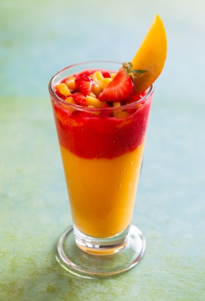 Glass of fresh mango and strawberry smoothie